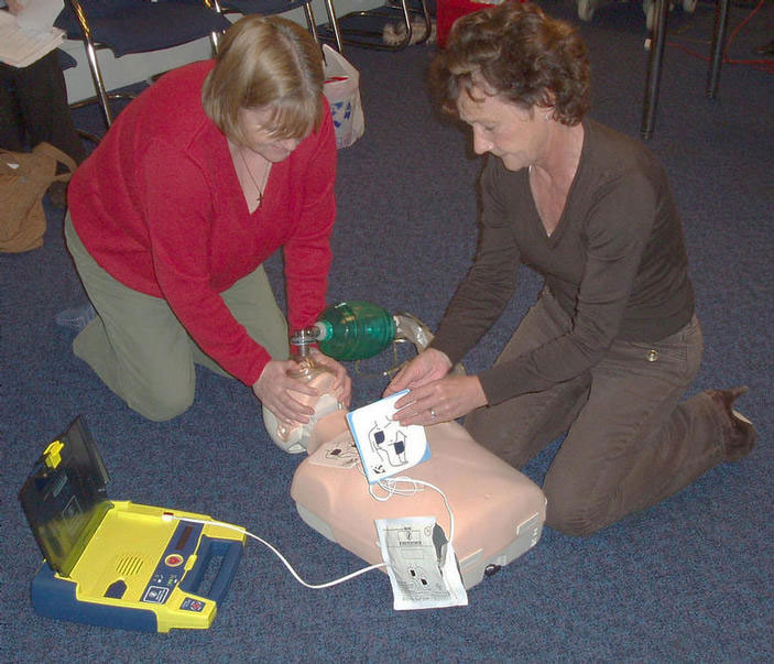 Trainees undertaking AED training